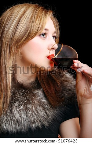 portrait of a beautiful sexy girl with a glass of wine - stock photo