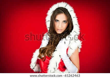 portrait of a beautiful sexy santa woman on red - stock photo
