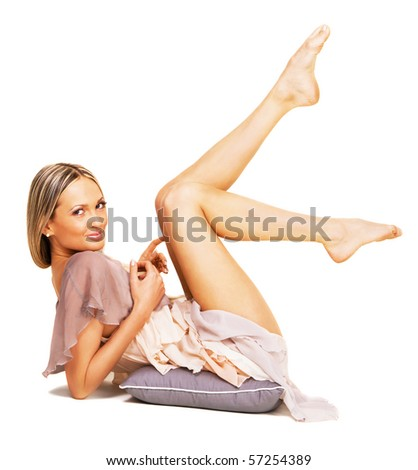 Portrait of a beautiful sexy woman in a chiffon dress - stock photo