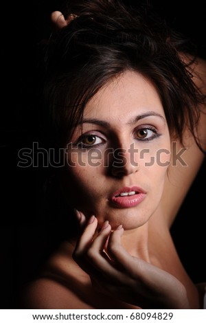 portrait of a beautiful sexy woman isolated on black