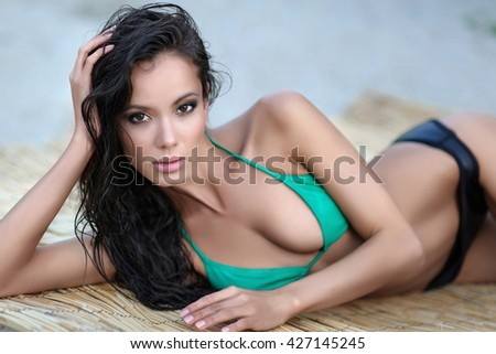 portrait of a beautiful sexy woman on the beach in summer