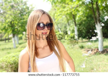 Portrait of a beautiful sexy woman outdoors in sunglasses - stock photo