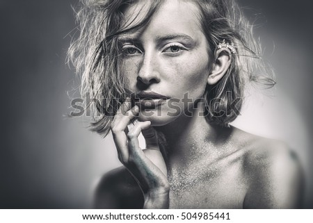 Portrait of a beautiful sexy woman with natural make-up. Black-and-white glamor  picture