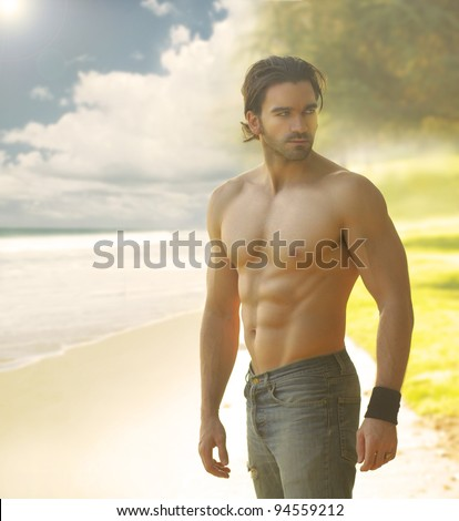 Portrait of a beautiful shirtless man in jeans against the light with a classic retro feeling - stock photo