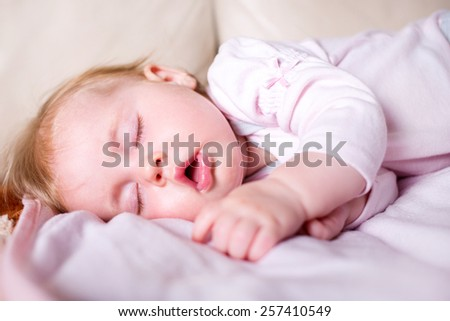 portrait of a beautiful sleeping baby on pink - stock photo