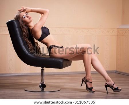 Portrait of a beautiful slim brunette woman in lingerie. - stock photo