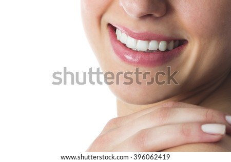 Portrait of a beautiful smile, isolated on white