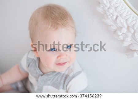 Portrait of a beautiful smiling baby on the white background - stock photo