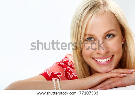 Portrait of a beautiful smiling blond looking at camera