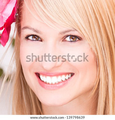Portrait of a beautiful smiling blonde woman. - stock photo