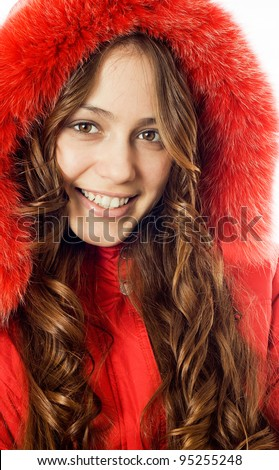 Portrait of a beautiful, smiling girl dress red fur coat - stock photo