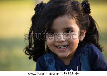 portrait of a beautiful smiling little girl - stock photo