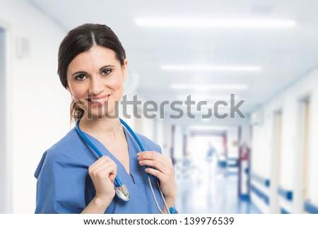 Portrait of a beautiful smiling nurse - stock photo