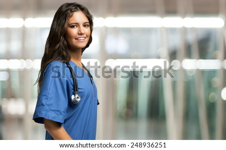 Portrait of a beautiful smiling nurse - stock photo