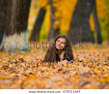 portrait of a beautiful smiling teenage in autumn time