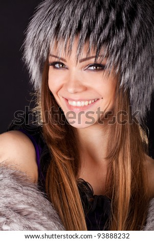 portrait of a beautiful smiling woman in furs - stock photo