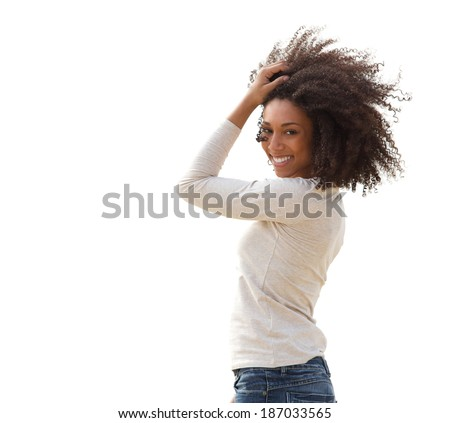 Portrait of a beautiful smiling young african american woman with hair in hair  - stock photo