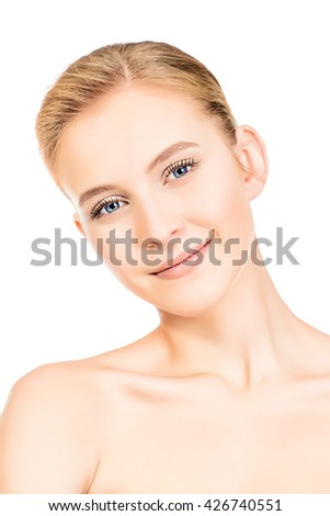 Portrait of a beautiful smiling young woman with natural make-up. Spa girl. Skincare, healthcare. Studio shot. Isolated over white. - stock photo