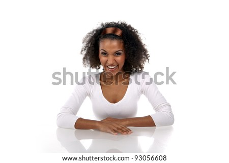 portrait of a beautiful smilling dark-skinned woman in a white dress in the studio - stock photo