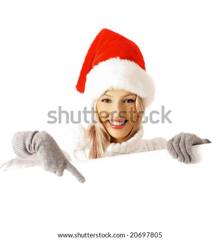 Portrait of a beautiful snata claus woman holding a blank billboard - stock photo