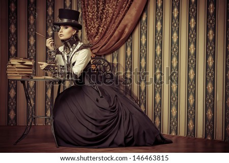 Portrait of a beautiful steampunk woman over vintage background. - stock photo