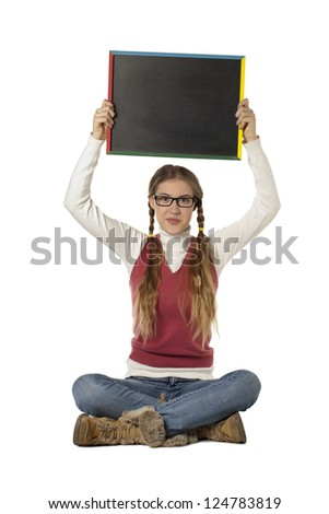 Portrait of a beautiful student raising a black board on a white surface - stock photo