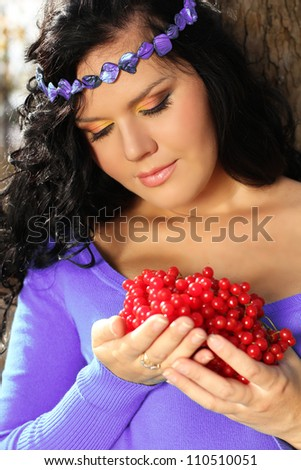 Portrait of a beautiful Summer Woman on vacation with berry in her hands - stock photo