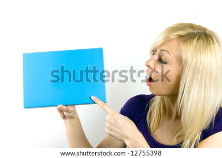 Portrait of a beautiful  surprised woman holding a blank blue notecard.
