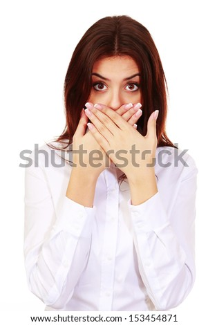 Portrait of a beautiful surprised woman with hands over her mouth isolated on white - stock photo