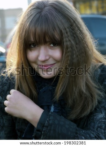 Portrait of a beautiful, sweet girl, a close-up. - stock photo