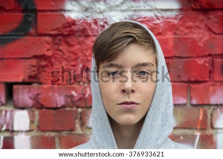 Portrait of a beautiful teenage boy with hoodie - stock photo