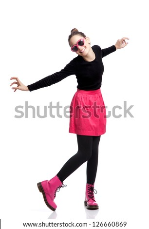 Portrait of  a beautiful teenage girl in love, smiling and dancing, isolated on white - stock photo