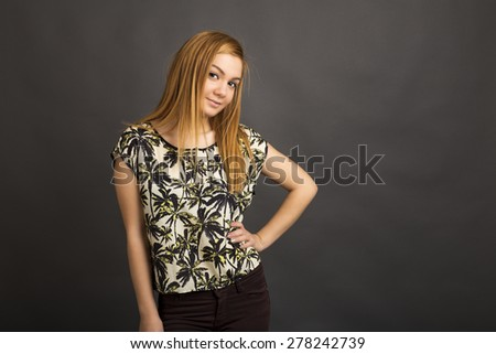 Portrait of a beautiful teenage girl  isolated over gray background - stock photo