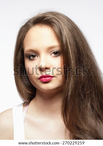 Portrait of a Beautiful Teenage Girl with Long Brown Hair - stock photo