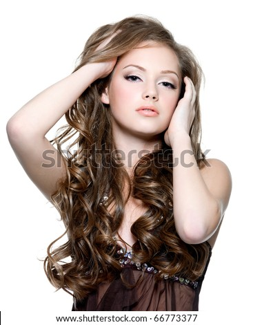 Portrait of a beautiful teenager girl with  long curly hairs - isolated on white - stock photo