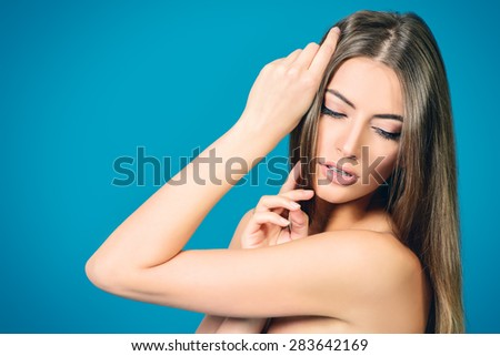 Portrait of a beautiful tender young woman with clean fresh skin. Youth and beauty. Skincare, bodycare. Spa. - stock photo