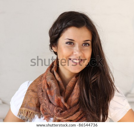 portrait of a beautiful woman against a white wall - stock photo