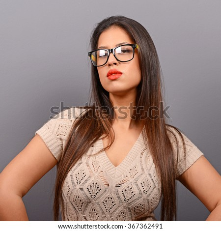 Portrait of a beautiful woman against gray background - stock photo