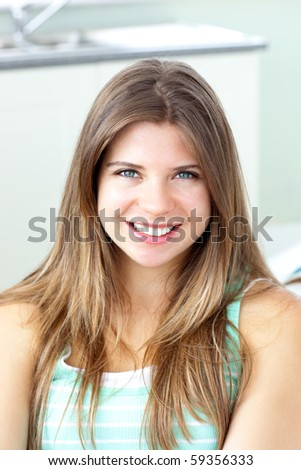 Portrait of a beautiful woman at home smiling at the camera