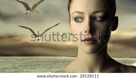 Portrait of a beautiful woman at the sea - stock photo