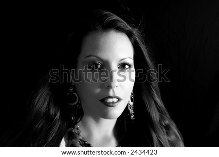 Portrait of a beautiful woman copy space isolated on black