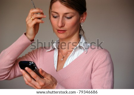 Portrait of a beautiful woman disappointed realizing that she forgot something - stock photo