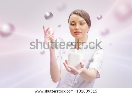 Portrait of a beautiful woman doctor presenting new medicine in blank white bottle. - stock photo