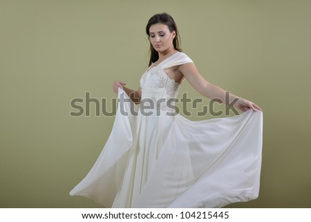Portrait of a beautiful woman dressed as a bride isolated on white background in studio