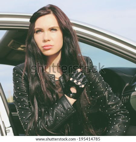 Portrait of a beautiful woman driving a sports car. Photo toned style Instagram filters - stock photo