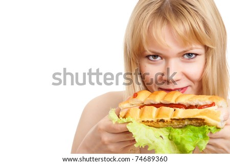 portrait of a beautiful  woman eating a hot dog - stock photo