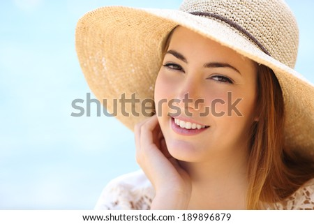 Portrait of a beautiful woman face in summer with a warmth light on the beach              - stock photo