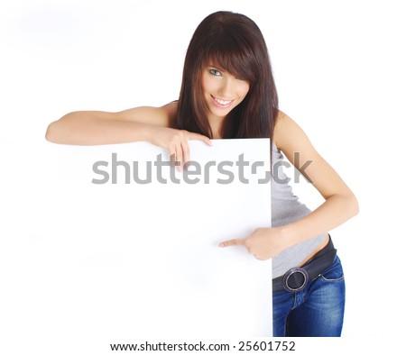 Portrait of a beautiful woman holding a blank billboard - stock photo