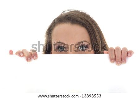 Portrait of a beautiful woman holding a blank billboard, looking for you