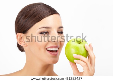 Portrait of a beautiful woman holding ripe apple